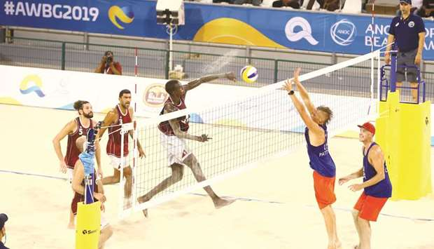 Qatar's Cherif Younousse spikes the ball against the USA at the Gharafa Sports Club yesterday. PICtu