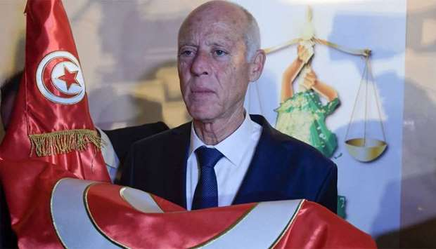 Conservative academic Kais Saied celebrates his victory in the Tunisian presidential election in the