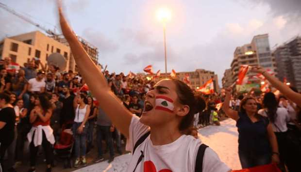 Lebanese demonstrators chant slogans as they take part in a rally in the capital Beirut's downtown d