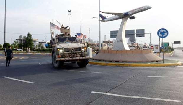 A convoy of US vehicles is seen after withdrawing from northern Syria, in Erbil, Iraq
