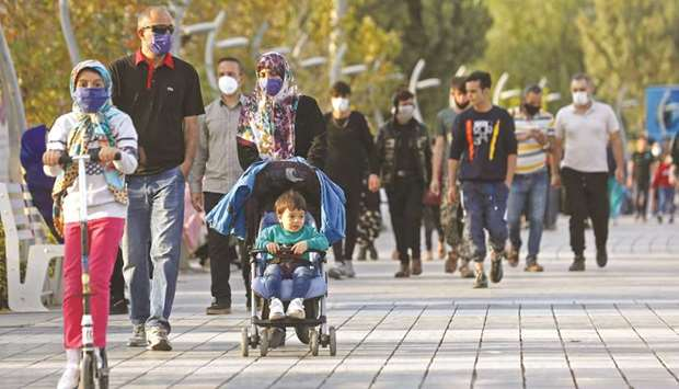 Iranian people wear masks, amid a rise in the coronavirus disease (Covid-19) infections, in West Teh