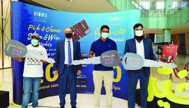 MoQ general manager Emile Sarkis hands over the car keys to the first three winners of the Shop and