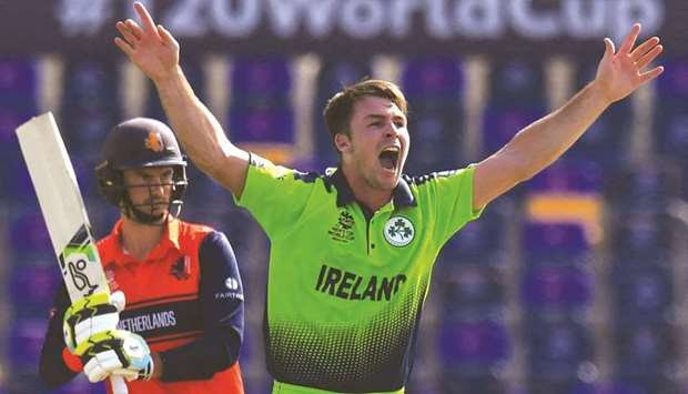 Ireland's Curtis Campher celebrates after taking the wicket of Netherlands's Scott Edwards during th