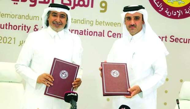 The officials at the MoU signing.