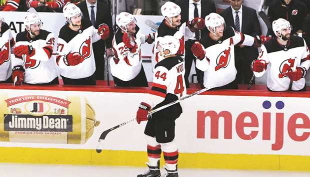 New Jersey Devils left wing Miles Wood (No 44) celebrates his goal against  the Chicago Blackhawks during the third period at United Center in Chicago. b2aa8d1f0