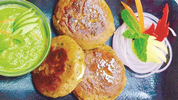 Traditional flavour from hyderabad belly full hyderabadi shikampuri kebab is a meat patty stuffed with seasoned and spiced hung curd photo by the author forumfinder Images