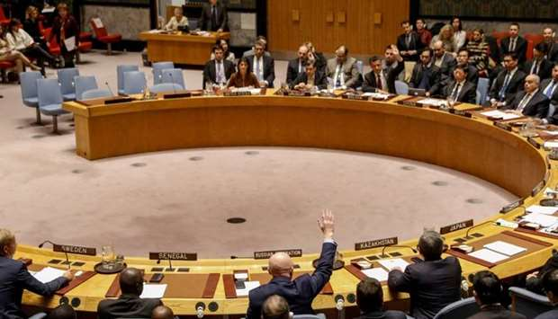Russian Ambassador to the United Nations Vasily Nebenzya votes against a bid to renew an internation