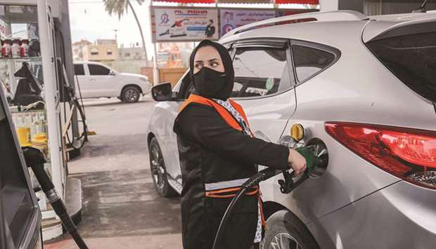Salma al-Najjar, a 15-year-old Palestinian who works at a petrol station to help her family with inc