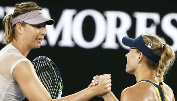 Angelique Kerber of Germany shakes hands with Maria Sharapova of Russia after Kerber won their match