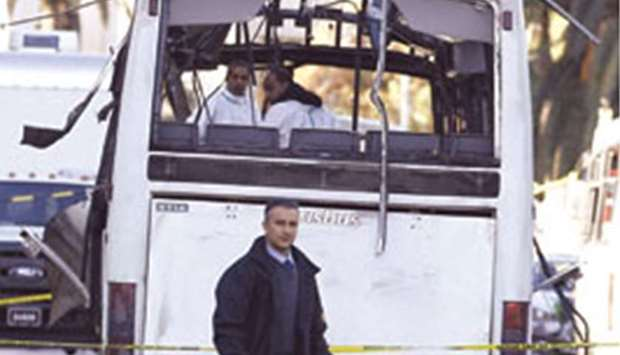 Forensics police inspect the presidential guard bus that was the target of Tuesday's suicide bomb at