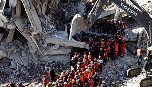 Rescue workers carry a body from the site of a collapsed building, after an earthquake in Elazig
