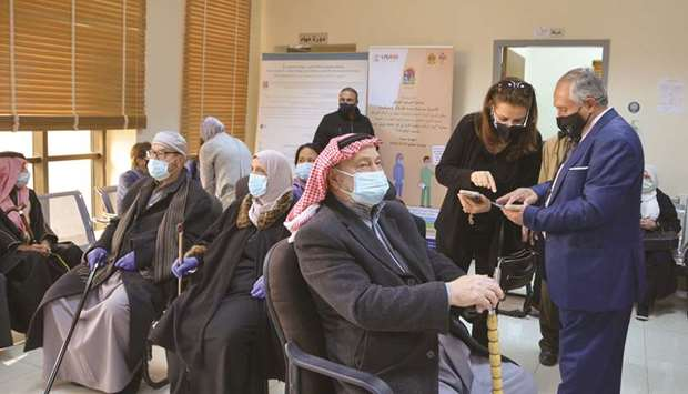 Jordanians wait to receive the Covid-19 vaccine, at a medical centre in Amman, yesterday.