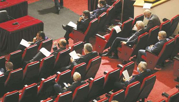 Lebanese members of parliament attend a legislative session yesterday.
