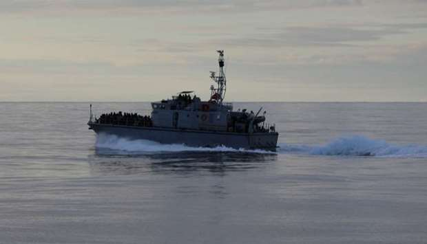 Migrants are seen on a boat as they are being rescued by Libyan coast guards at the coast of Tripoli
