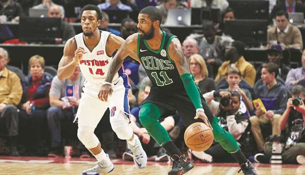 0f65734310c Boston Celtics guard Kyrie Irving (right) dribbles while defended by Detroit  Pistons guard Ish Smith in the second-half of their NBA game at Little  Caesars ...