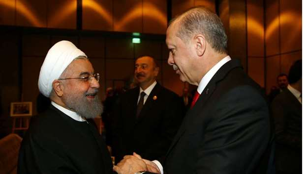 Turkish President Tayyip Erdogan meets with Iran's President Hassan Rouhani during an extraordinary