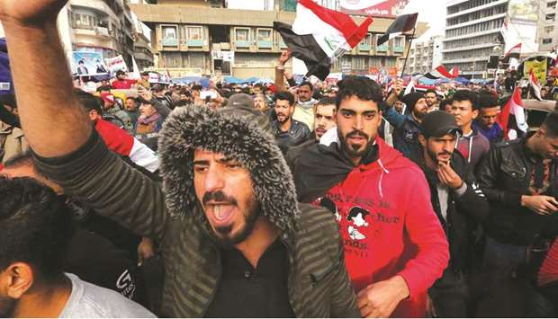 Iraqis gather at Tahrir square in Baghdad amid ongoing anti-government protests, yesterday.
