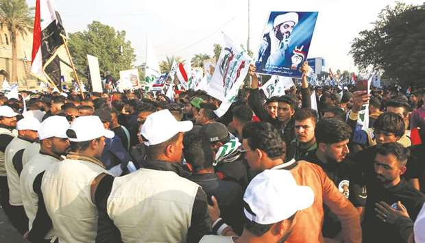 Supporters of Qais al-Khazali, leader of the Asaib Ahl al-Haq militia group, gather during a demonst