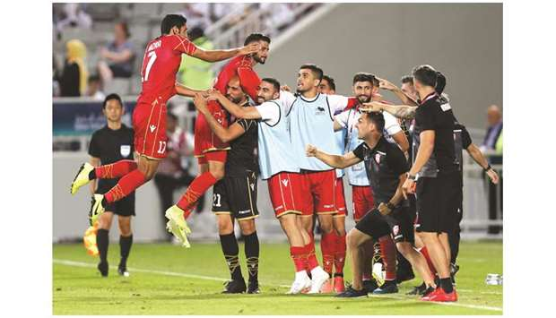 Bahrain players celebrate their win over Iraq in the semi-final against Iraq on Thursday. PICTURE: A
