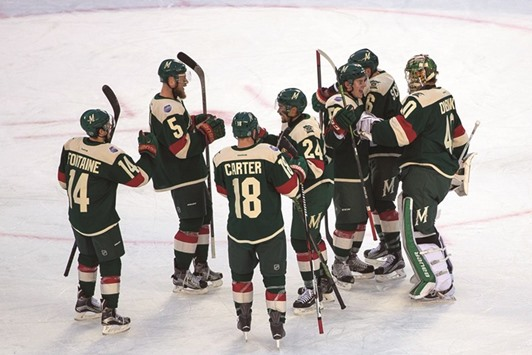 Minnesota Wild players celebrate their win against the Chicago Blackhawks  in a stadium series game at TCF Bank Stadium in Minneapolis. PICTURE  USA  TODAY 3d19b4e25
