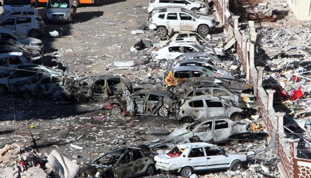 Damaged cars are seen after Friday's explosion outside a housing complex in the Turkish town of Vira