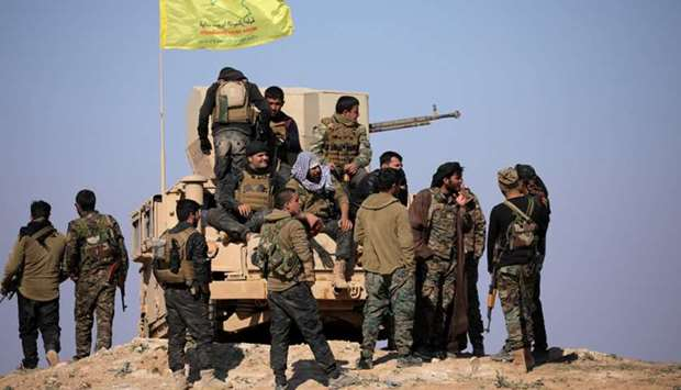 Members of Syrian Democratic Forces (SDF) stand together near Baghouz, Deir Al Zor province, Syria F