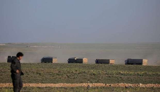 Trucks move near Baghouz, Deir Al Zor