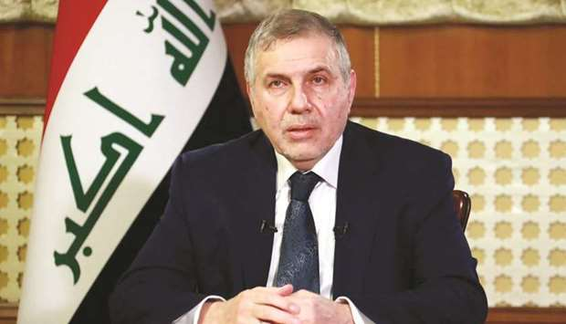 Iraqi Prime Minister Mohamed Tawfiq Allawi delivers a televised speech in Baghdad, yesterday.