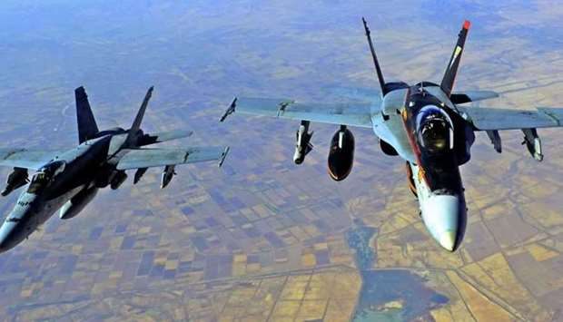 In this file US Navy handout image taken on October 4, 2014 two US Navy F-18E Super Hornets supporti