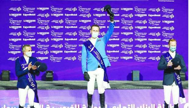 Commercial Bank CHI Al Shaqab presented by Longines Grand Prix winner Germany's Christian Ahlmann (c
