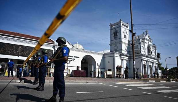 Security personnel stand guard outside St. Anthony's Shrine in Colombo