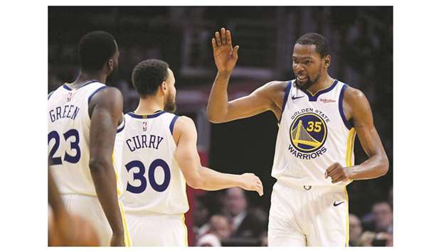 1dd9531c324 Kevin Durant of the Golden State Warriors (right) celebrates a double digit  lead over the LA Clippers with Stephen Curry (centre) and Draymond Green in  the ...