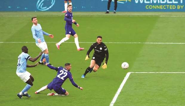 Chelsea's Hakim Ziyech (second right) scores against Manchester City in the FA Cup semi-final at the