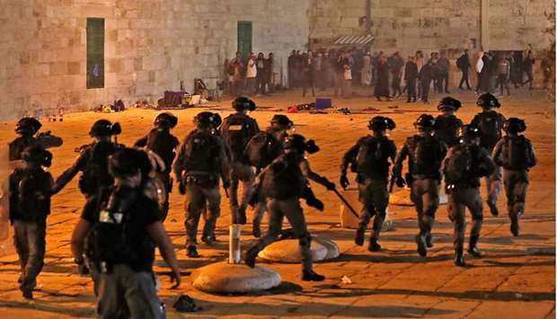 Israeli security forces advance amid clashes with Palestinians at the al-Aqsa mosque compound in Jer