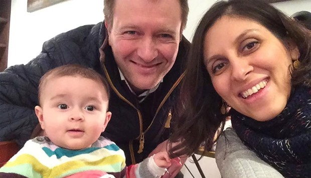 Nazanin Zaghari-Ratcliffe (R) posing for a photograph with her husband Richard and daughter Gabriell