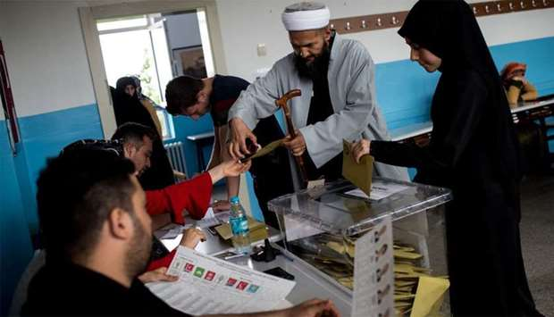 People vote in snap twin Turkish presidential and parliamentary elections in Istanbul