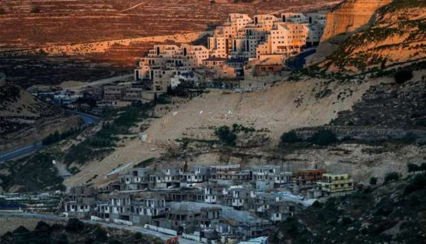 A view of ongoing construction work at the Israeli settlement of Givat Zeev, near Ramallah in the oc