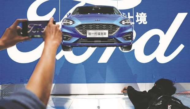 A New Ford Focus Is Presented During A Media Preview Of The Auto China  Motor Show In Beijing Ford Motors China Slump Intensified With Vehicle Sales