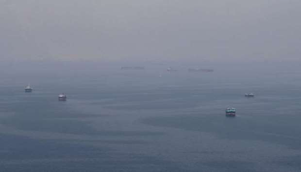 Traditional Omani boats known as dhows, and cargo ships are seen sailing towards the Strait of Hormu