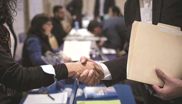 US job growth surges, but wage growth remains tepid