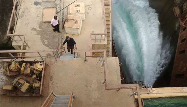 Syrian workers are seen at the Tabqa dam