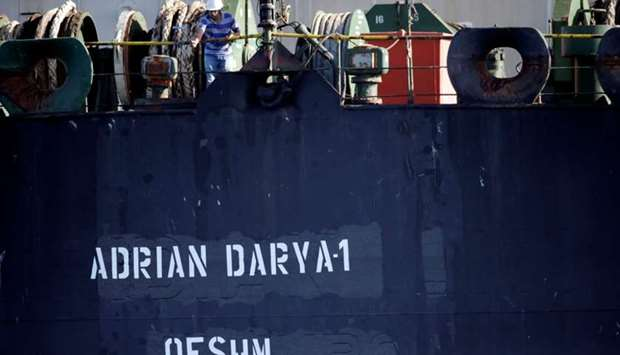 A crew member takes pictures with a mobile phone of Iranian oil tanker Adrian Darya 1, previously na
