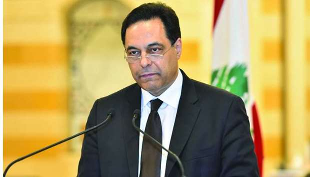 Prime Minister Diab announcing his government's resignation yesterday