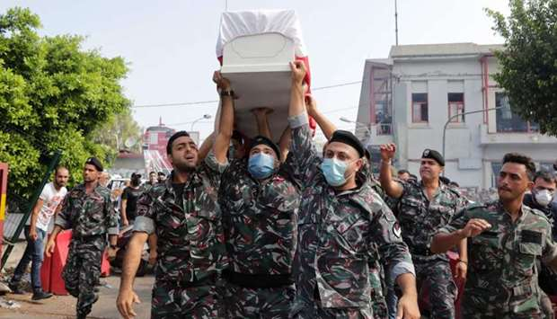 Firefighters carry the coffin of their colleague Joe Noun, who was killed in Beirut's massive blast,