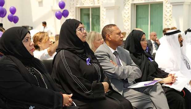 Participants attend presentations at the event.