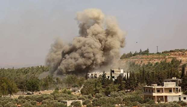 Smoke billows following a reported Russian airstrike on the western outskirts of the mostly rebel-he