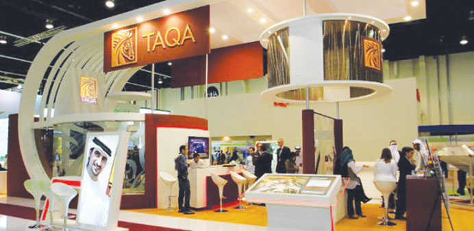 Taqa profit hit by lower gas prices, tax charge