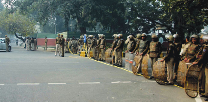 Security forces are deployed near Finance Minister Arun Jaitley's residence yesterday. Hundreds of A
