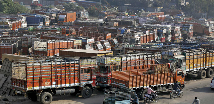 Trucks are seen parked in an open plot near a national highway on the outskirts of Ahmedabad. India