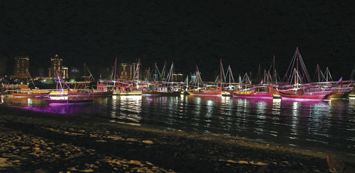 Dhows which have arrived for the festival serve as Katara's attractions at night.